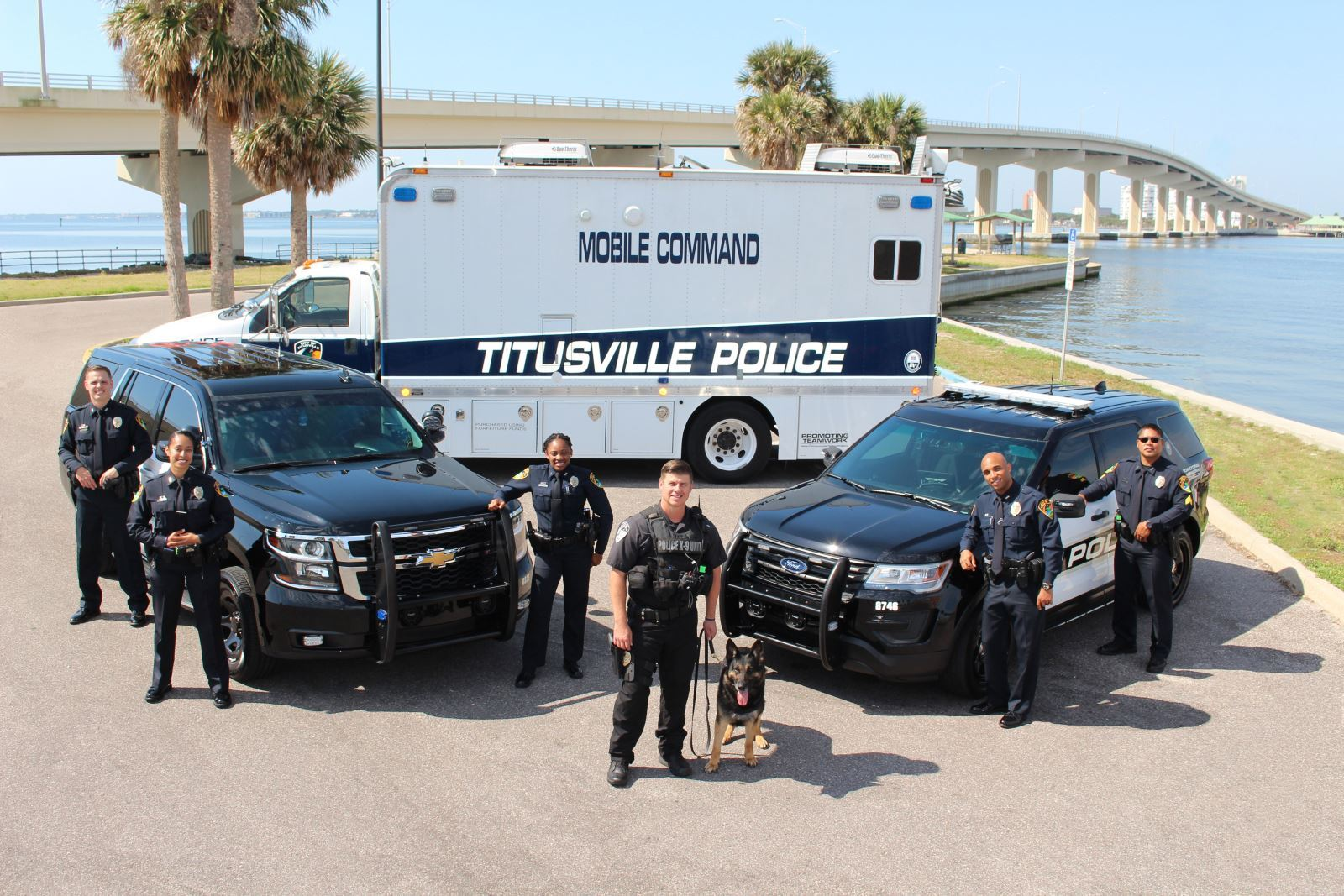 Officers Standing with Titusville Mobile Command Vehicles